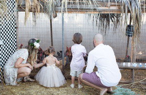 visiting the chicken coop in our family photo session | the love designed life