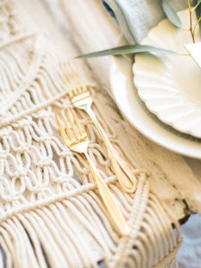 gold flatware on a macrame table runner, ftw | styled by paige of the love designed life