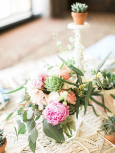 perfect spring peonies, ranunculus, and baby aritchoke floral arrangement and boho tablescape by paige of the love designed life