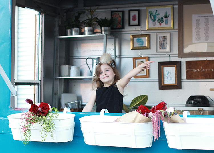 i'd buy flowers from this cutie any day | the love designed life