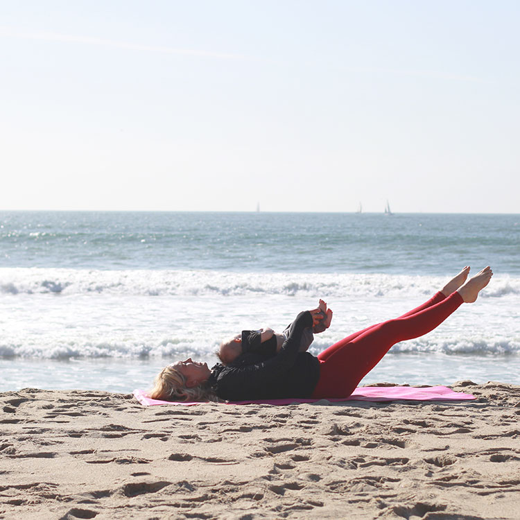 'swimming' legs. move baby's legs as you move yours! | m and m pilates on the beach | the love designed life
