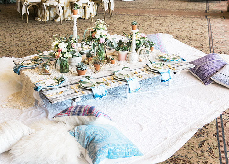 a boho festival themed tablescape for the tables that bloom charity event benefitting the foundation for the blind| designed by the love designed life