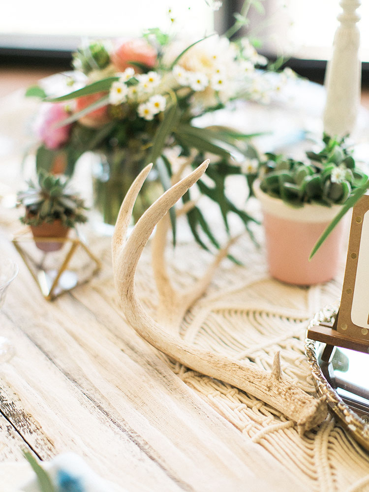 antler shed table detail on the boho festival chic table design for tables that bloom charity event | the love designed life