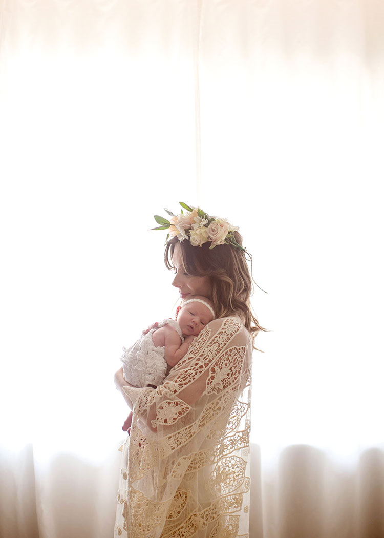 love this sweet silhouette of boho mama and her newborn babe by the window captured for the mother + child co. project | the love designed life