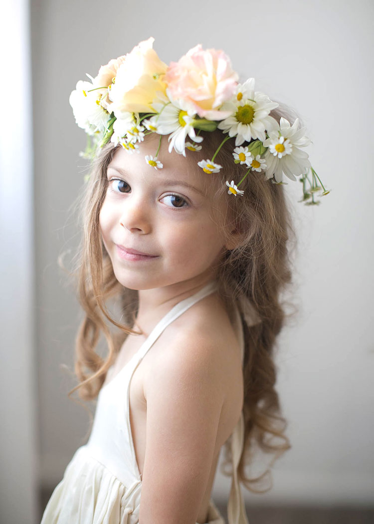 a sweet portrait of a little girl with a fresh flower crown by mother + child co. | the love designed life