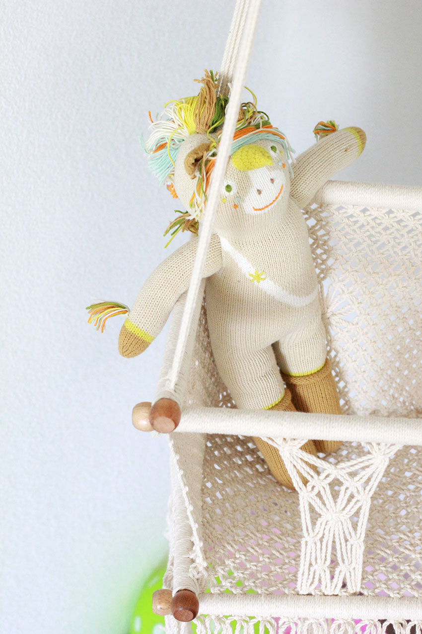 legend the unicorn checking out the macrame baby swing for #diegosfirstfiesta | the love designed life