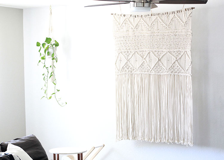 obsessed with this oversized macrame piece and our little macrame plant holder too. | the love designed life