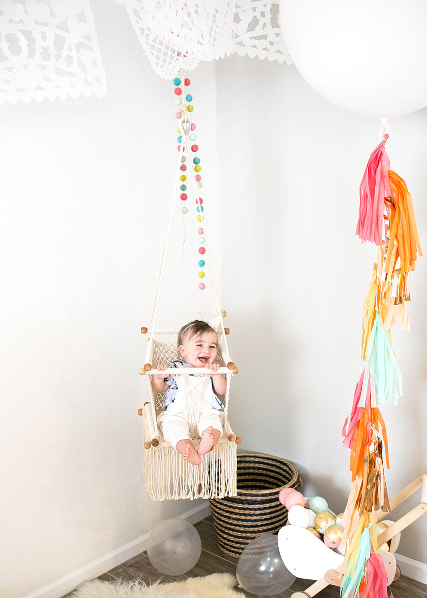 happy birthday boy in his new swing margarita + sangria bar for diego's first fiesta | created by: the love designed life | pc: dream photography studio