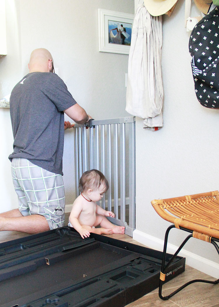 baby helping dad with gate instal | the love designed life