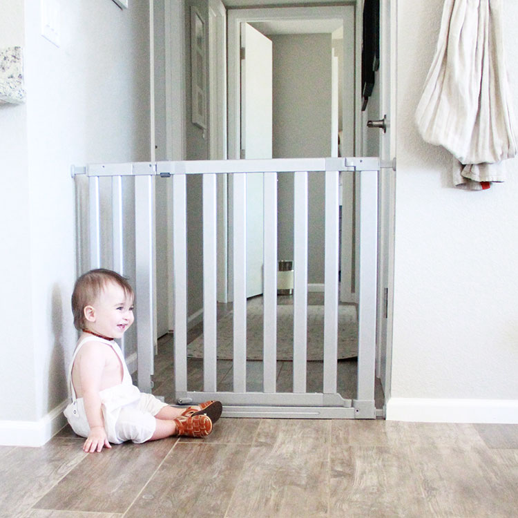 happy about being contained by his new munchkin baby gate | the love designed life