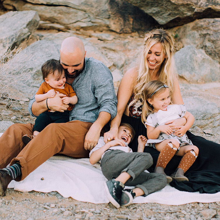 tickle fight | boho desert family photo session | thelovedesignedlife.com