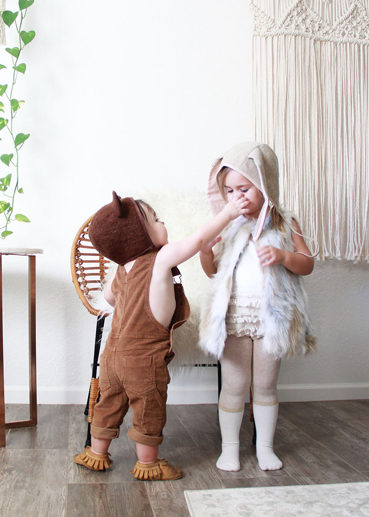 trying to play with sister's bunny nose | baby halloween costume ideas on thelovedesignedlife.com