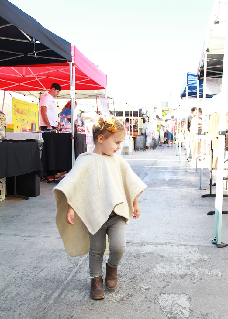 browsing the farmers' market in her mar y lana poncho | thelovedesignedlife.com