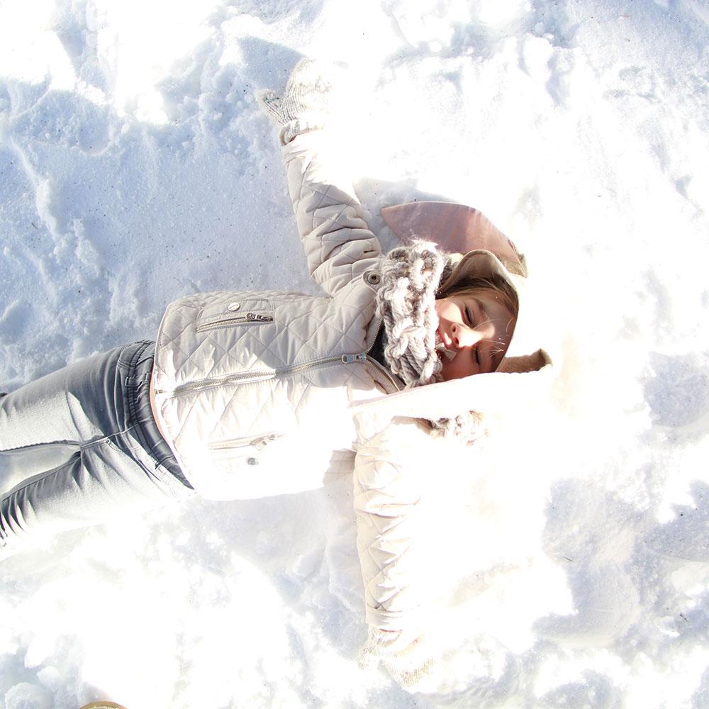 snow bunny making a snow angel | thelovedesignedlife.com