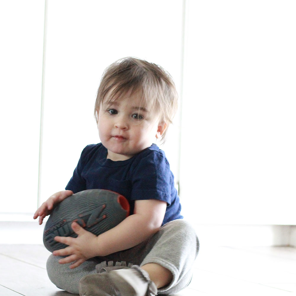 sweet boy on a floor cleaned by a robot named bObi.   thelovedesignedlife