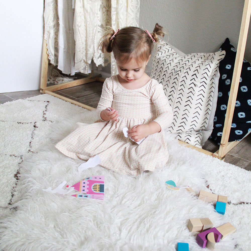playing with her felt dolls from her mom 'n tot box this month | thelovedesignedlife.com