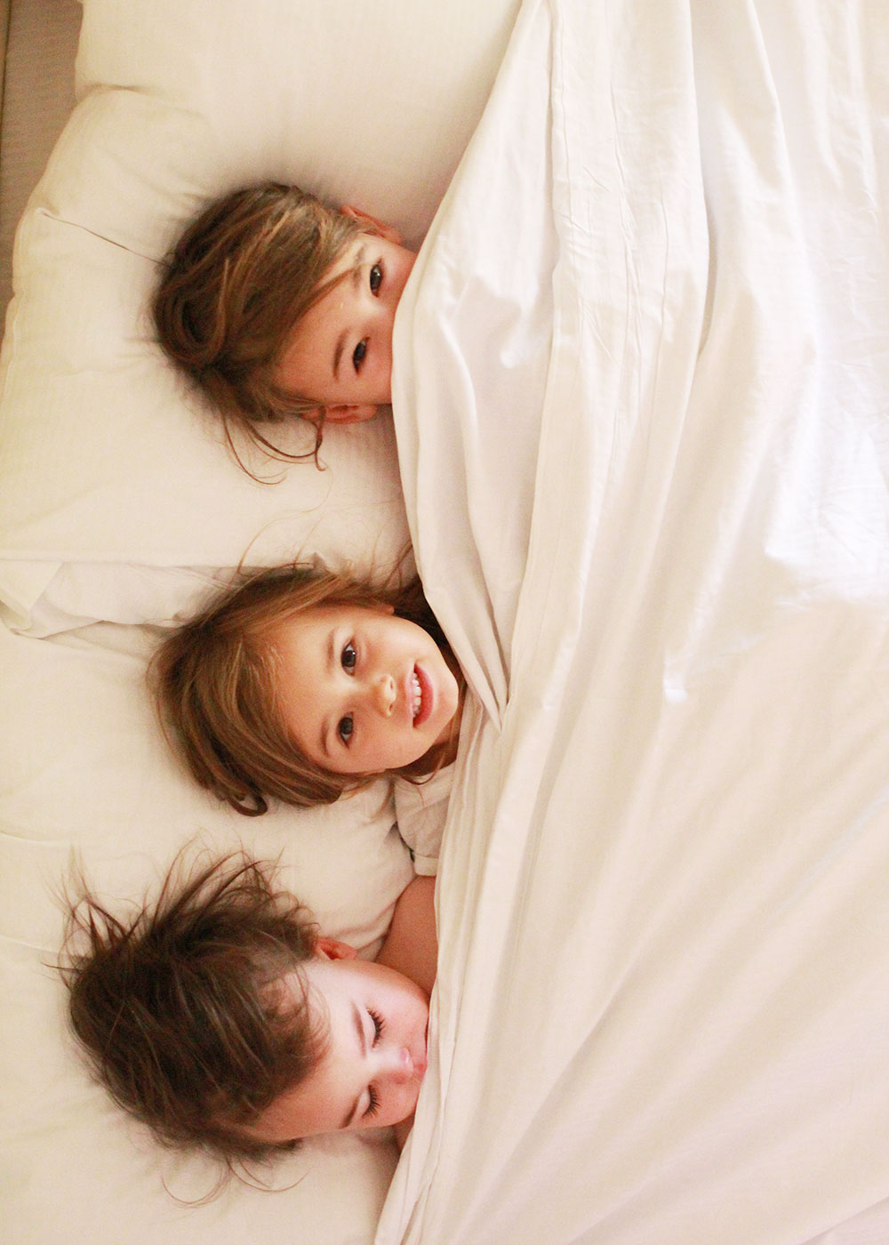 three little monkeys in the point hilton squaw peak resort bed! | thelovedesignedlife.com