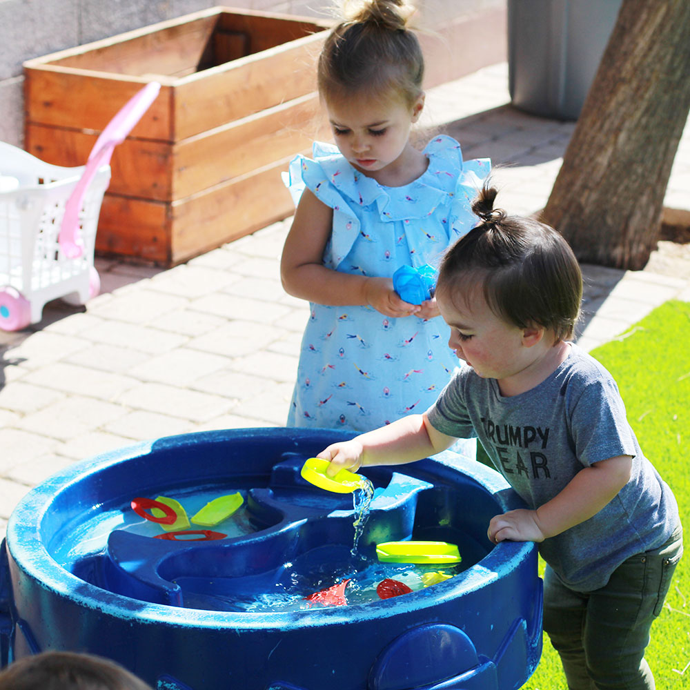 playing at the water table at our local KidsPark drop-in childcare | thelovedesigendlife.com