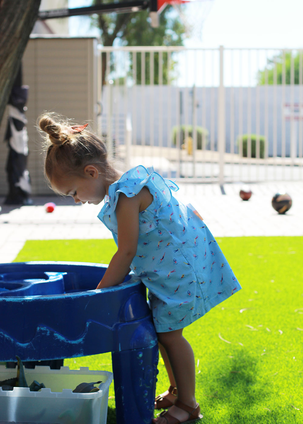 my girl playing at the water table at our local KidsPark | thelovedesigendlife.com