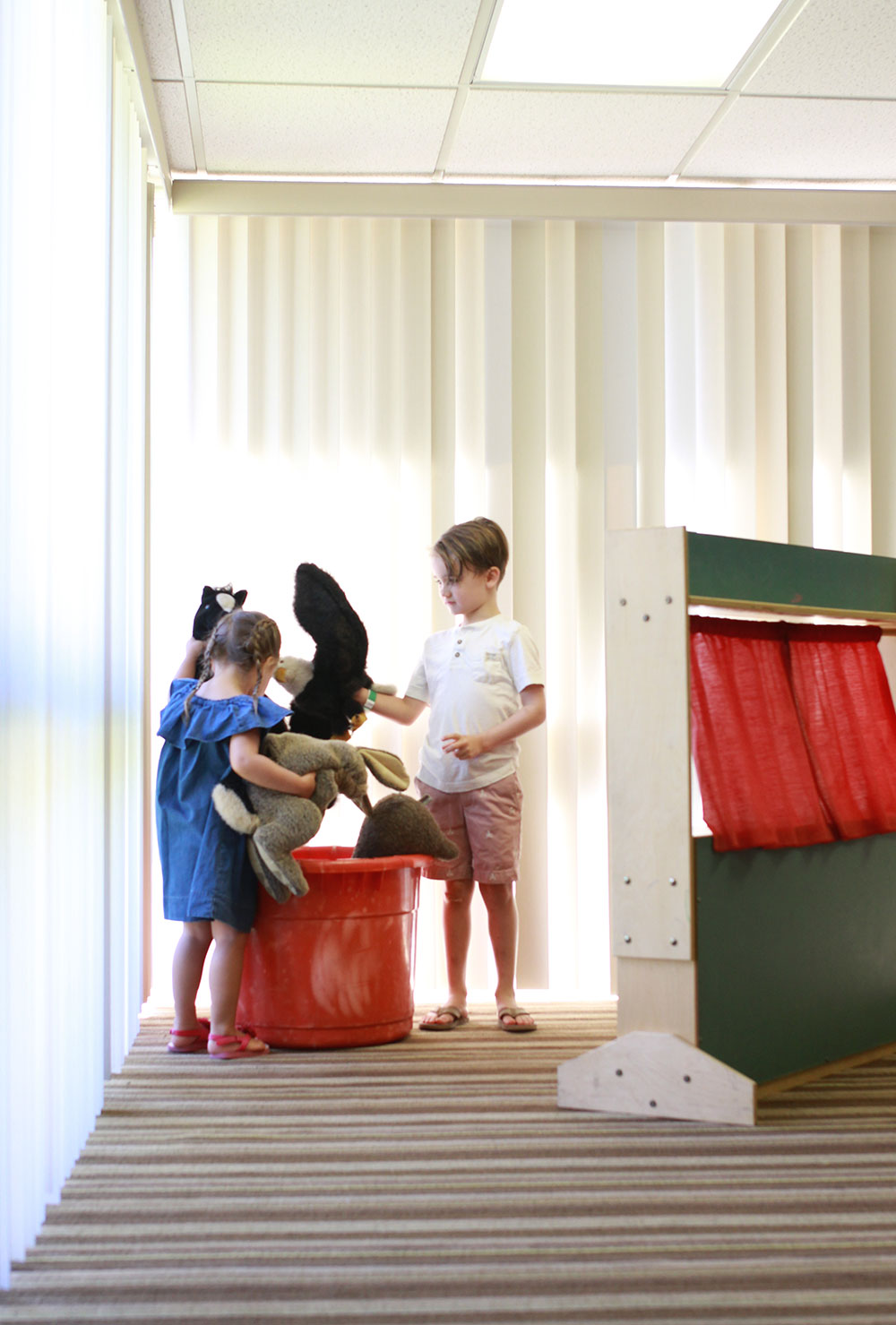 setting up for a puppet show in the coyote kids camp at the pointe hilton squaw peak resort | thelovedesignedlife.com