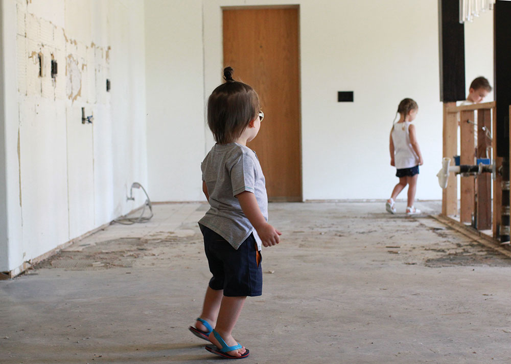 sweet kiddos in the empty kitchen before our renovation | thelovedesginedlife.com