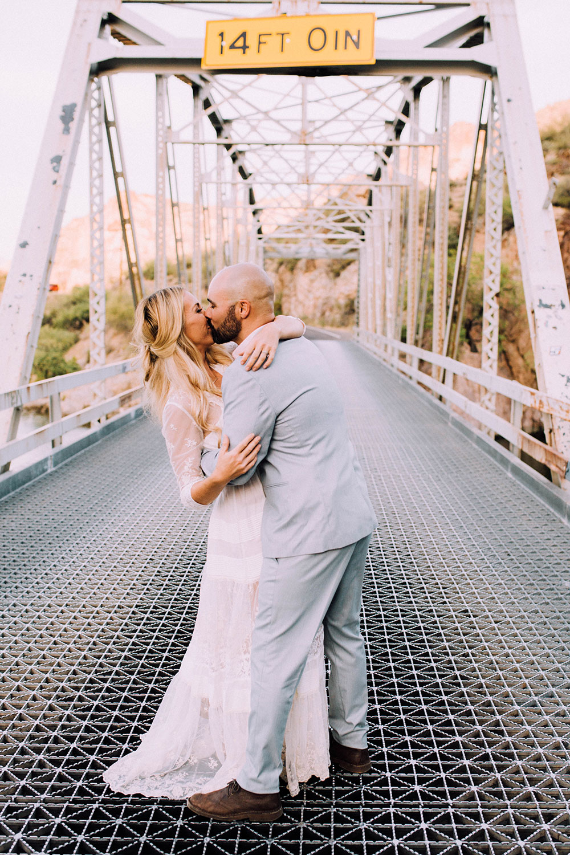 romantic boho wedding anniversary photos on a bridge | thelovedesignedlife.com