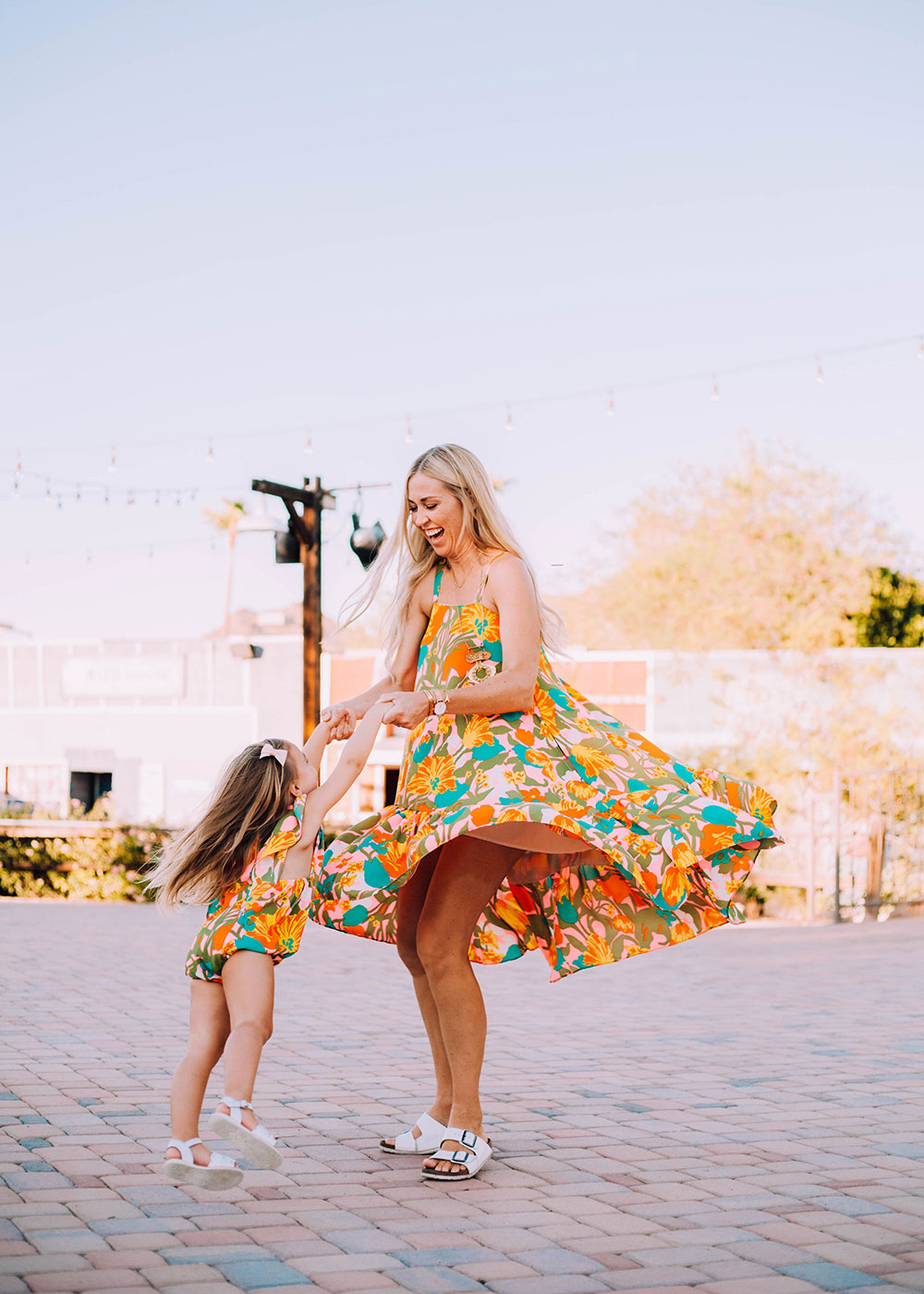 twirling with my sweet girl in our matching crew + lu outfits | thelovedesignedlife.com