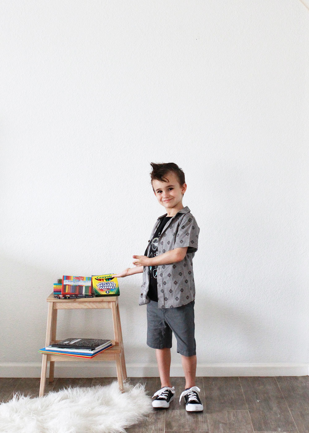 this cool kid checking out all his school supplies for back to school | thelovedesigendlife.com