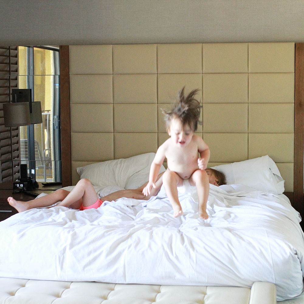 monkeys jumping on the hotel bed | thelovedesignedlife.com