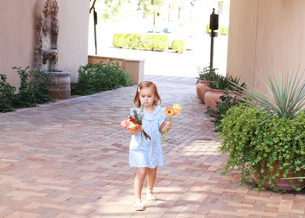 sweet little girl sorting her flowers | #themomblogcollective thelovedesignedllife.com