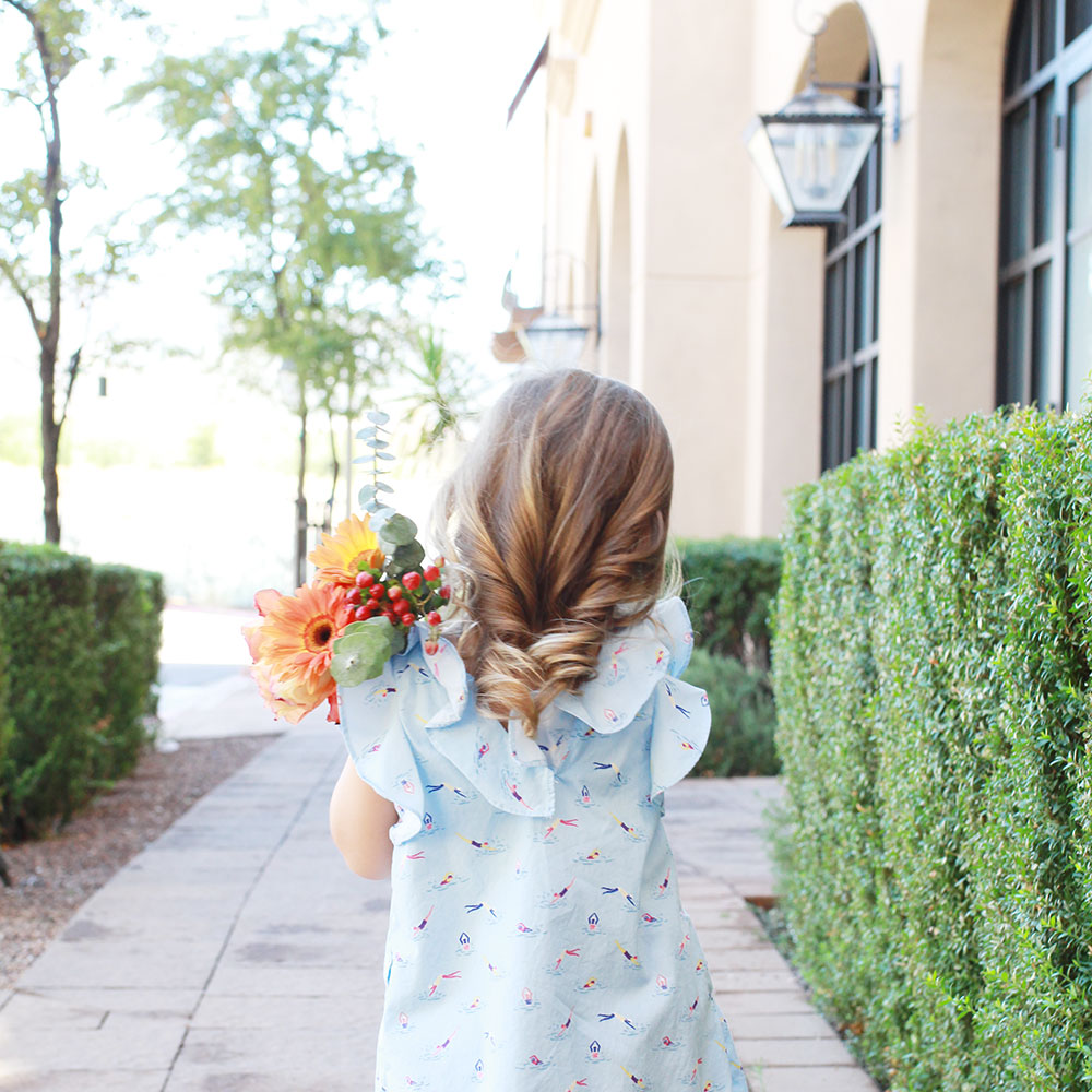 perfect little girl curls and pretty flowers. | #themomblogcollective week 2: building your community and defining your brand | thelovedesgnedlife.com