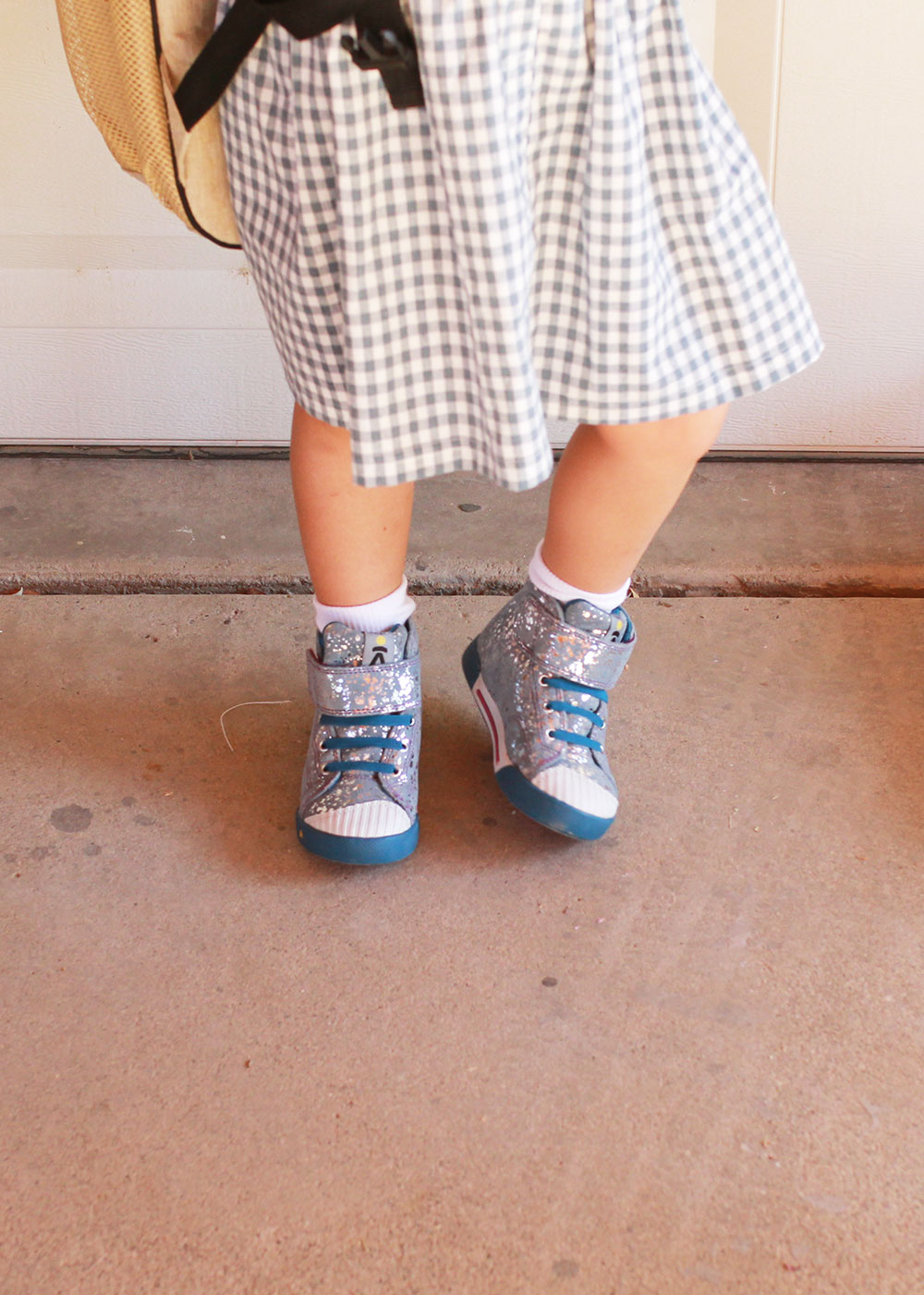 loving these little girl's silver foil print high top shoes. perfect for back to school! | thelovedesignedlife.com