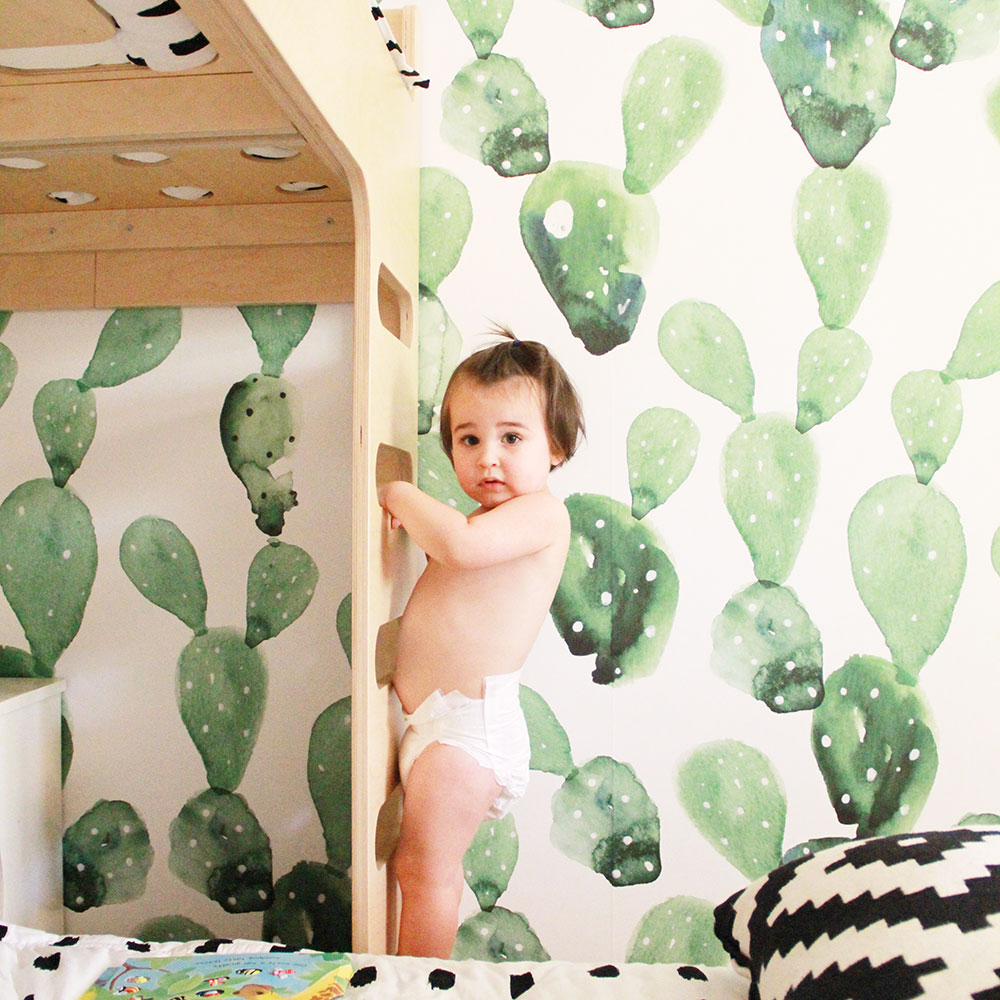 cutest little trouble maker climbing his brother's bunk bed by the cactus wallpaper | thelovedesignedlife.com