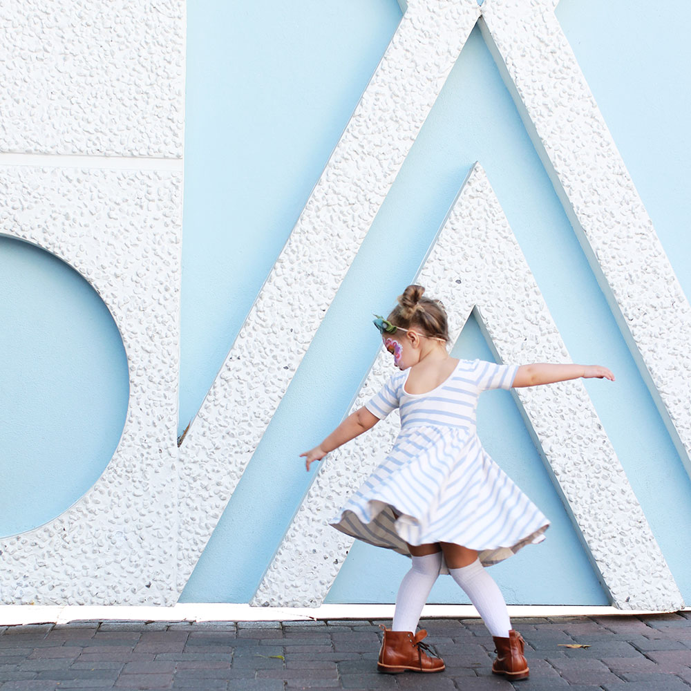 my sweet little girl twirling her way by small world at disneyland | thelovedesignedlife.com