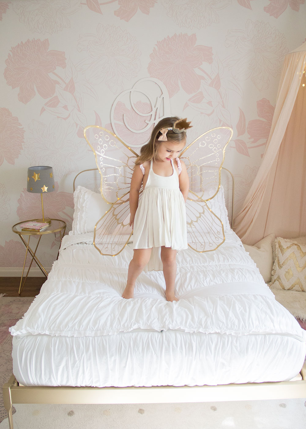 this little fairy girl is loving her super easy beddy's bedding for her new big girl room! | thelovedesignedlife.com