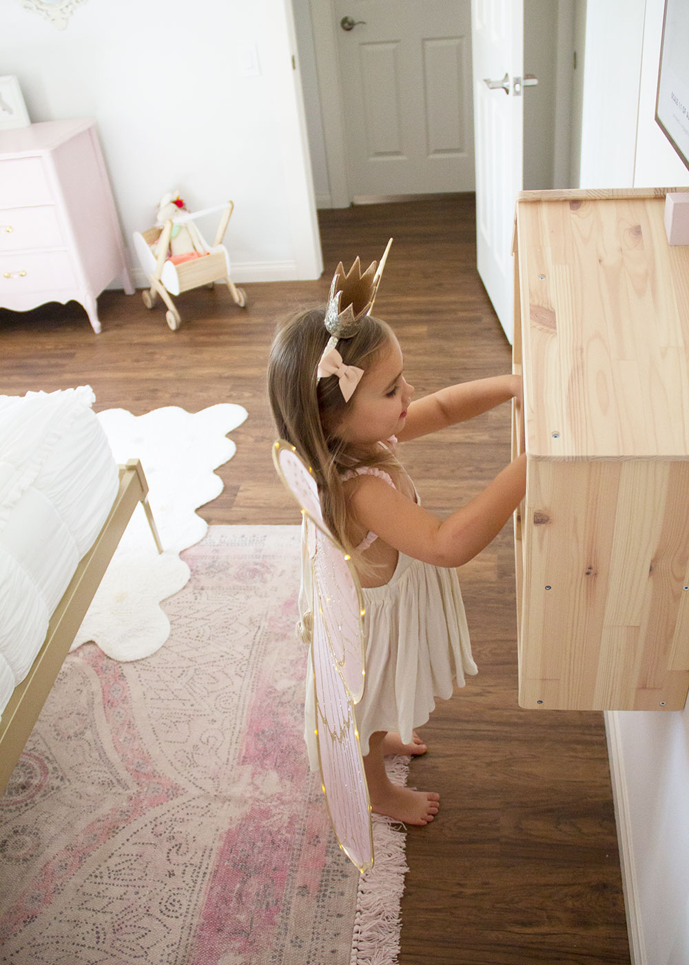 sweet little girl playing with the dollhouse in her new big girl room! | thelovedesignedlife.com