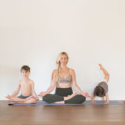 mom practicing yoga with her two little boys | thelovedesignedlife.com