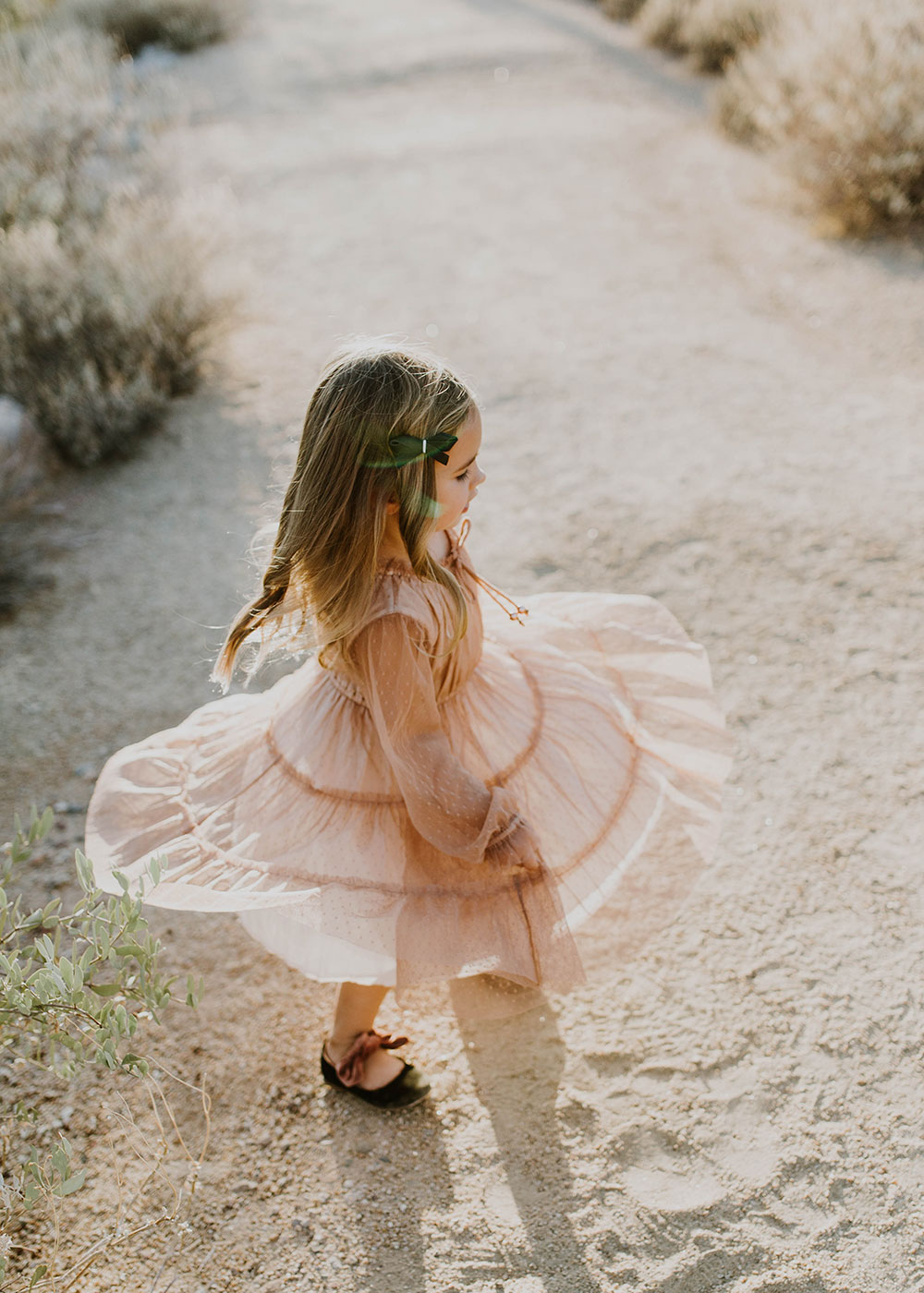 sweet little girl twirling in her pink swiss dot dress #familyphotos | thelovedesignedlife.com