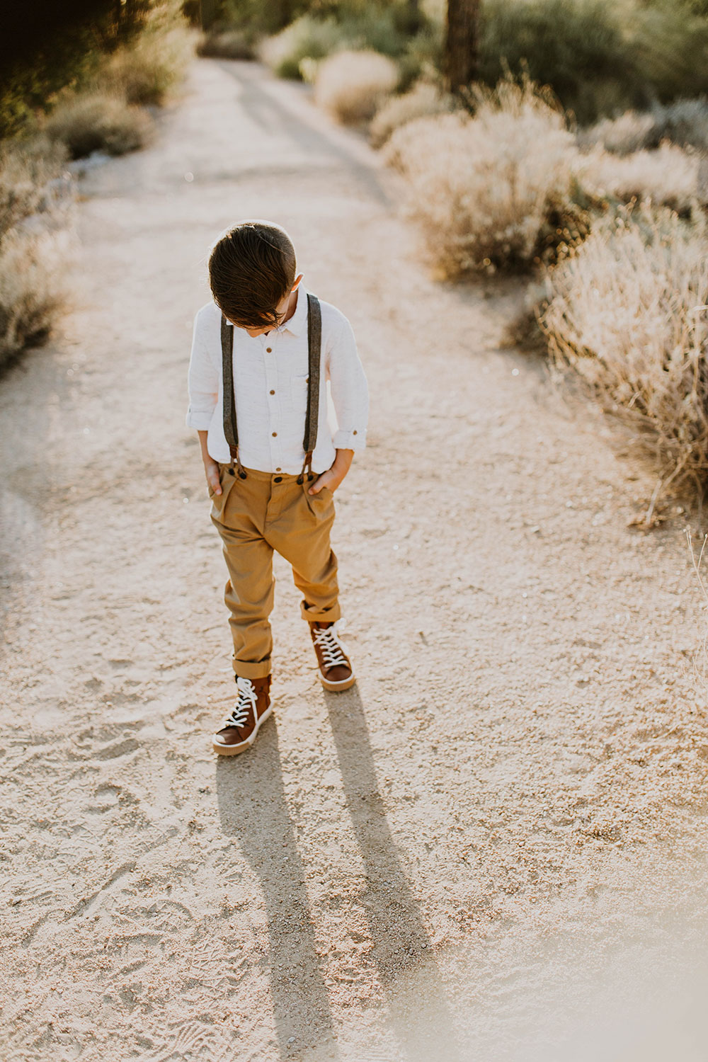 handsome young man in his suspenders #familyphotos #boysclothes #outfitideas | thelovedesignedlife.com