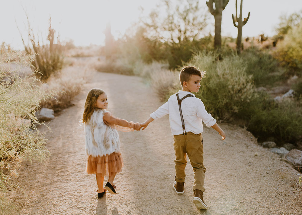 love this sibling shot in desert boho family photos #familyphotos #siblinglove | thelovedesignedlife.com