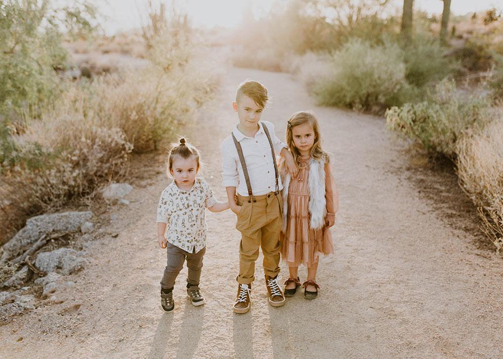 I love non-smiling photos sometimes. #familyphotos #siblinghoodlove #manbun #desertfamilyphotos | thelovedesignedlife.com