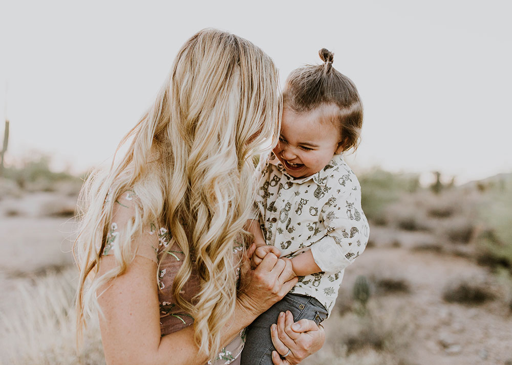 tickle your kids to get the smiles out. #familyphotos #desertvibes | thelovedesignedlife.com