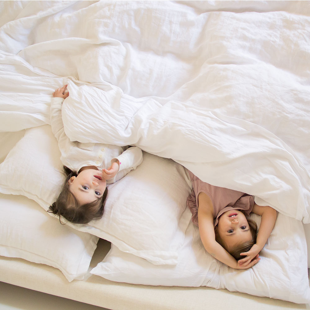 these two testing out the softest sustainable bedding from the company store | thelovedesignedlife.com