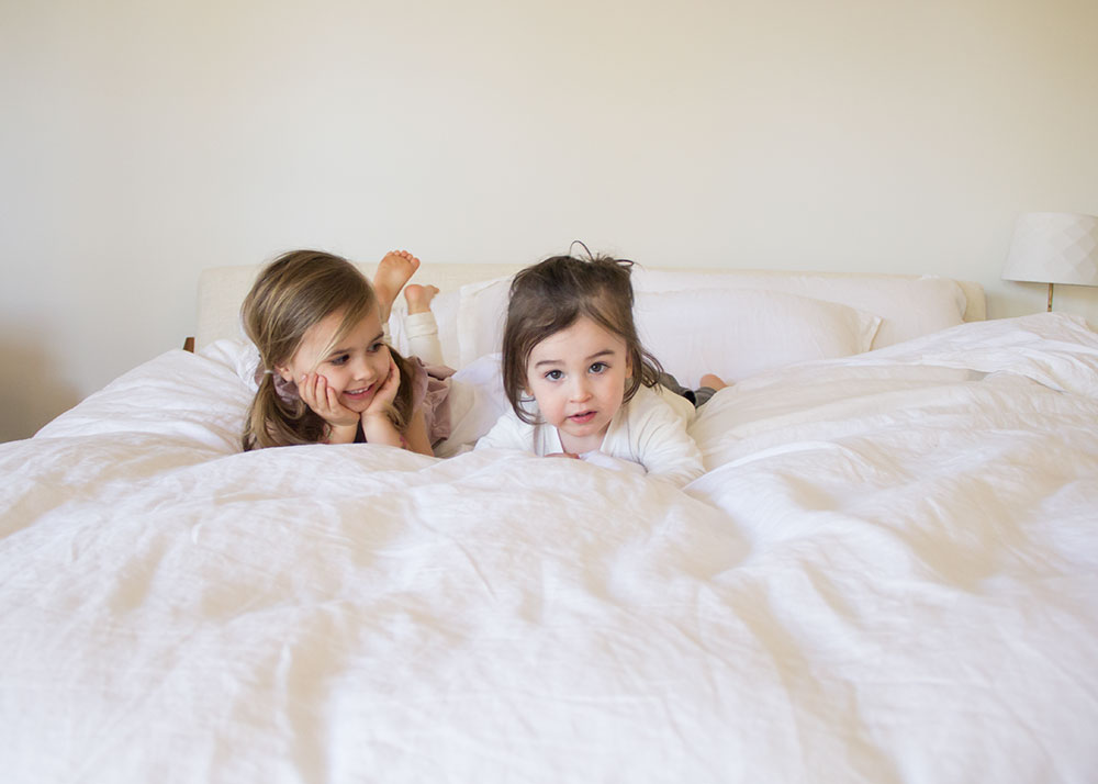 my babies testing out our new master bedroom super soft bedding | the lovedesignedlife.com #thecompanystore #softestbedding #masterbedroom
