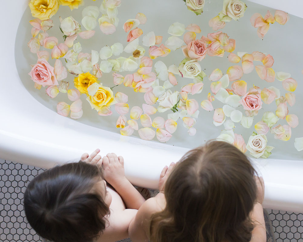 prepping a flower bath for my little ones at bedtime | thelovedesignedlife.com #bathtime #flowerbath #bedtimeroutine