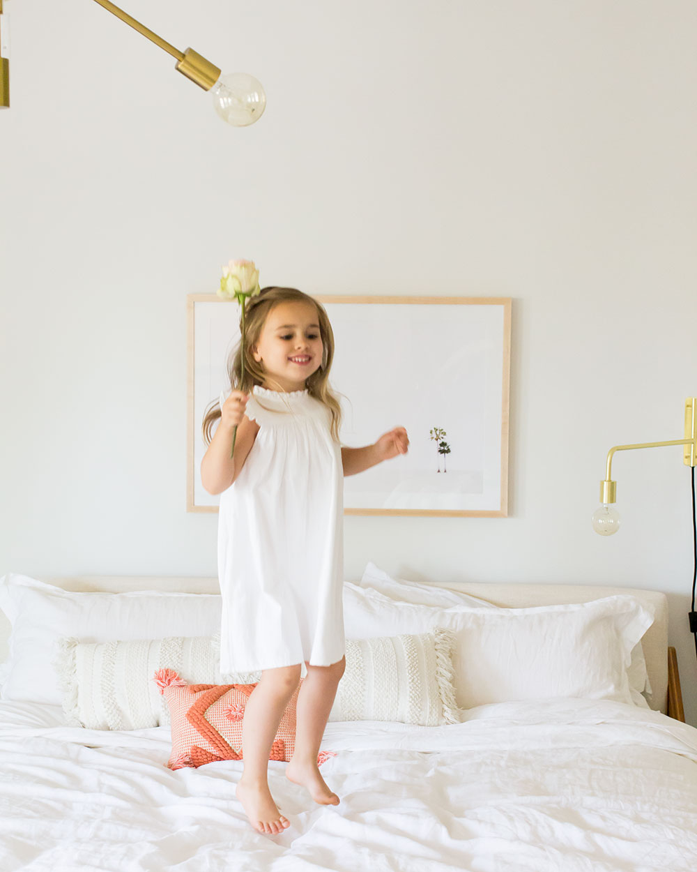 jumping for joy in our master bedroom reveal | thelovedesignedllife.com #theldlhome #masterbedroom #childhood