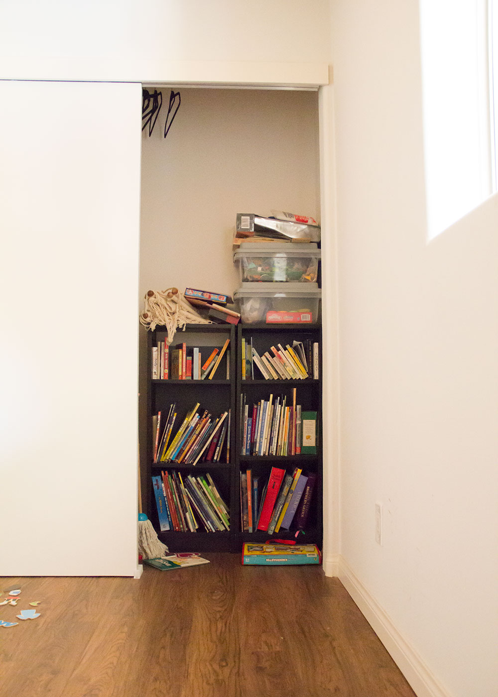 our current playroom closet. we need a better way to store the kids books!   thelovedesignedlife.com #mariekondoxcoclosets #playroom