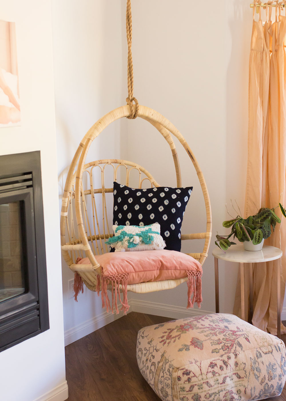 love this hanging chair in this pretty bedroom! | thelovedesignedlife.com #bohovibes #masterbedroom