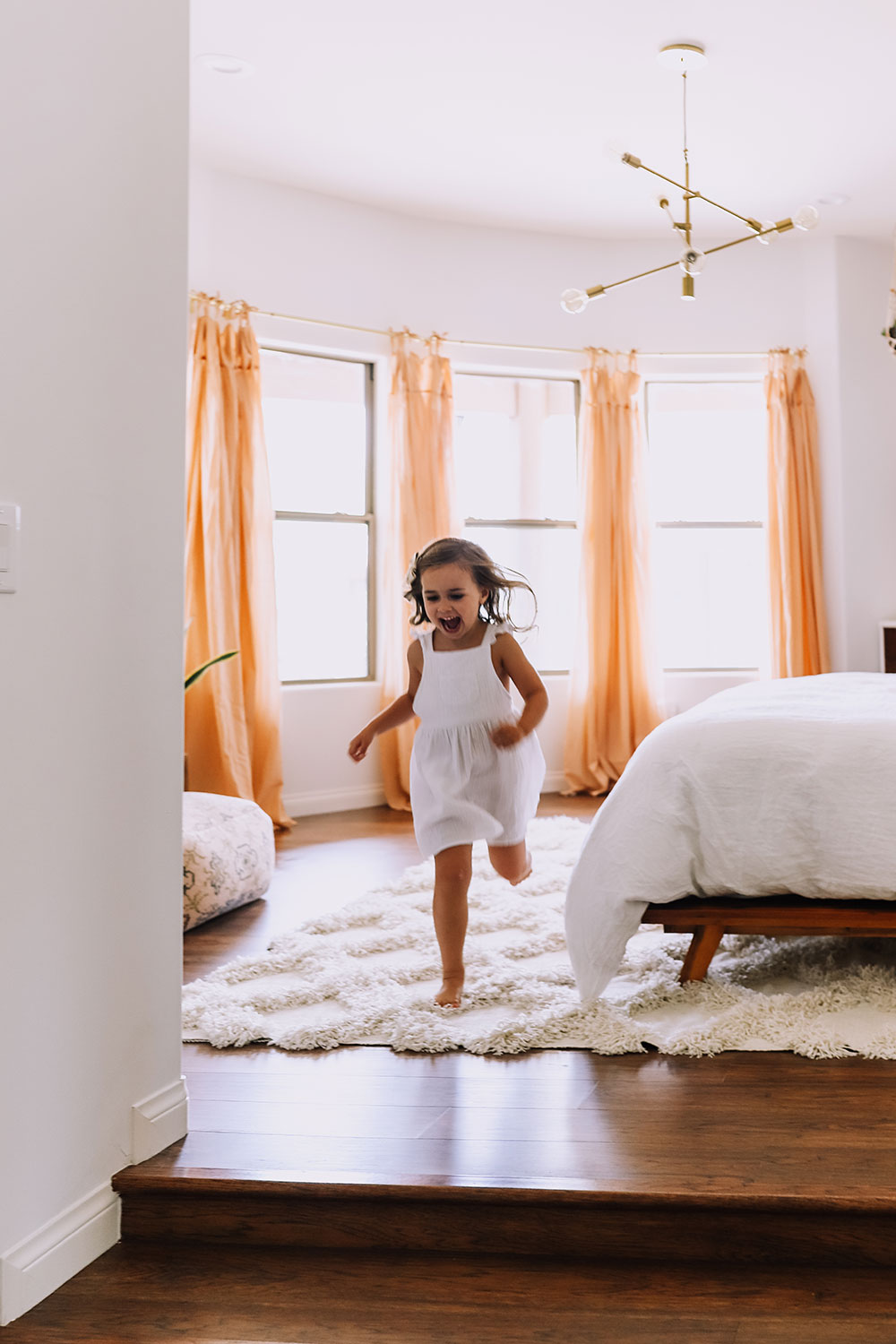 little girl in master bedroom | thelovedesignedlife.com #childhood #happiness