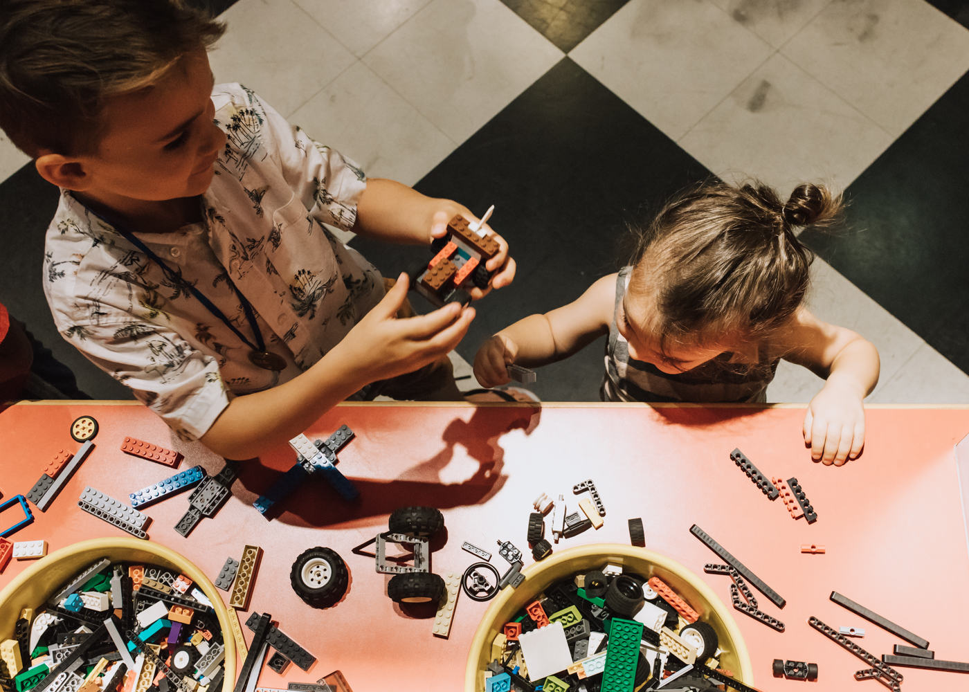 the kids building cars to race on the track at LEGOLAND Discovery Center Arizona | thelovedesignedlife.com